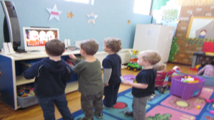 Children dancing and playing with the Wii